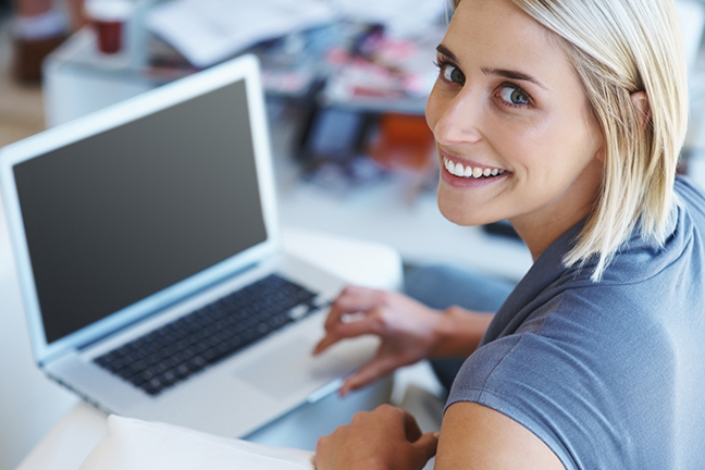 woman & laptop on the pc tune up and speed up page.